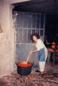 Mother canning tomatoes