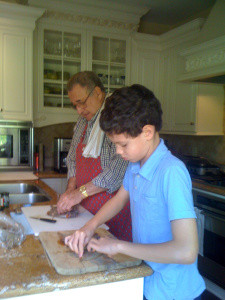 Thirty years later, their children cleaning fish with their dad and the children's grandpa on a Sunday afternoon