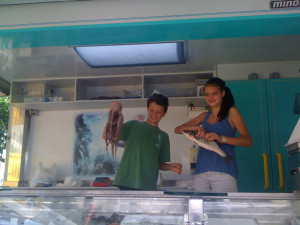 Laila and Bo buying fish they will clean and cook